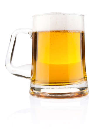 light beer in glass mug isolated on white background
