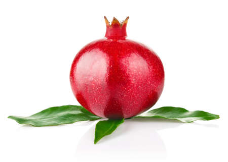 royal ripe pomegranate with green leaves isolated on white background Stock Photo