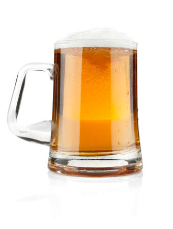 isolation tank: full mug fresh beer with froth isolated on white background