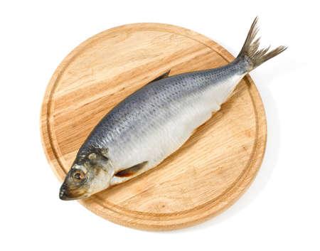 herring on wooden hardboard isolated white background