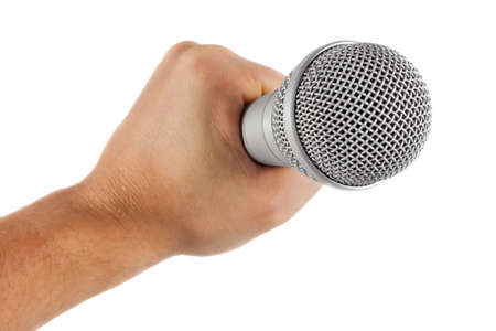 grey microphone in hand isolated on white background photo