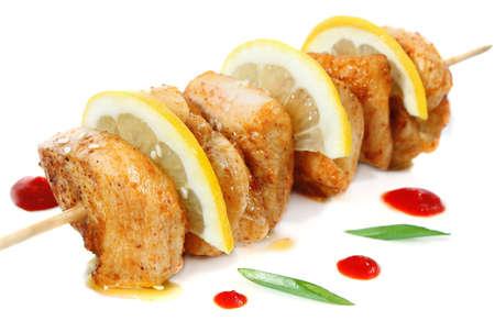 karri: chicken shish kebab with lemon isolated on white background