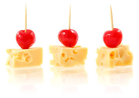 piece cheese with cocktail cherry isolated on white background photo