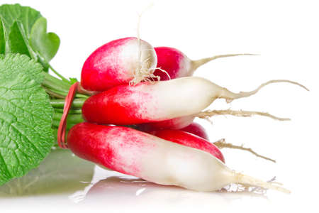 red radish with green leaves isolated on white background photo
