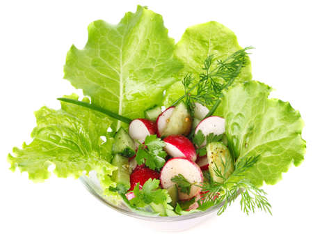 salad of fresh vegetable and greenery isolated on white background photo