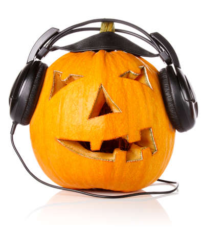 Halloween Pumpkin.Scary Jack O'Lantern in headphones isolated on white background Stock Photo - 15352957