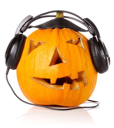 Halloween Pumpkin.Scary Jack O'Lantern in headphones isolated on white background Stock Photo - 15352957