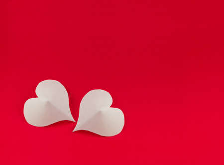 White hearts on red background Stock Photo