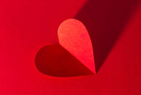 Paper heart on red background for valentines day