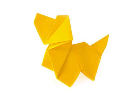 Yellow dog origami. Isolated on white background