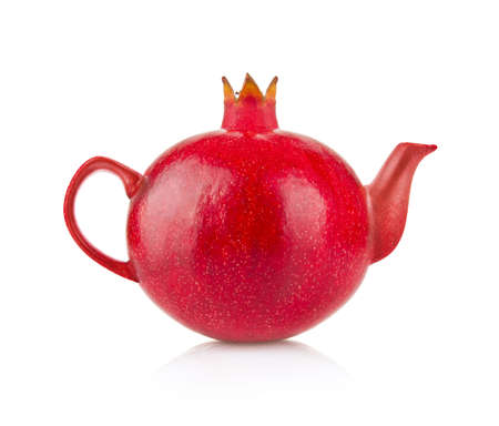 Creative conception of royal pomegranate and kettle. Isolated on white background Stock Photo