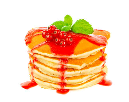 Pancake with red currant sauce and green leaf of mint, isolated on white background