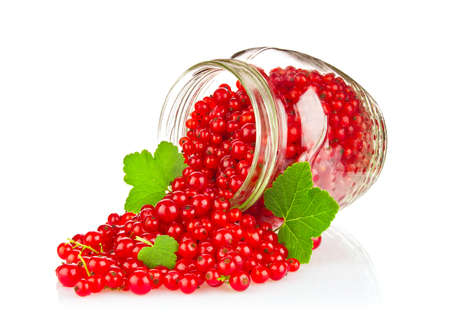 Fresh Red Currant with Green Leaf in glass jar Isolated on White Background Stock Photo
