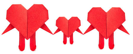 Family of red heart origami, isolated on white background. Stock Photo