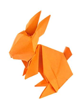 Orange easter bunny of origami, isolated on white background Stock Photo