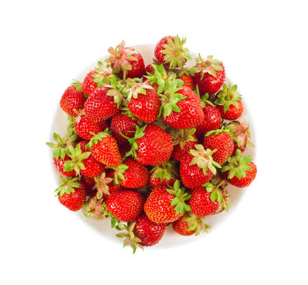 Ripe organic strawberry in tureen with green leaves and flower isolated on white background Stock Photo