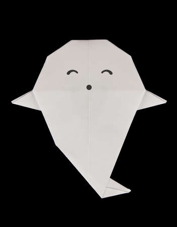 Kind ghost of origami, isolated on black background.