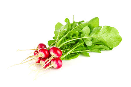Fresh organic farm radishes with green leaves, isolated on white background. Stock Photo