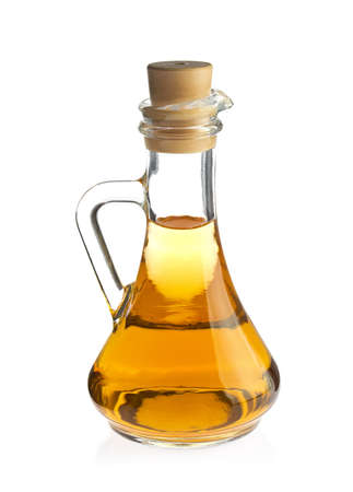 Decanter with organic apple vinegar, isolated on white background. Stock Photo