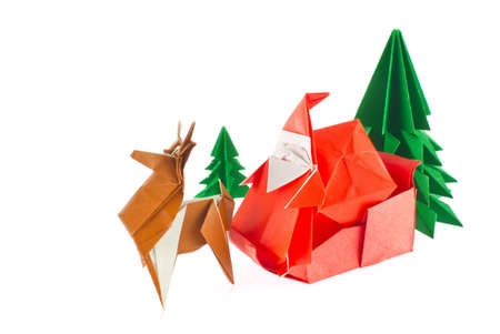 Christmas composition of origami, isolated white background.