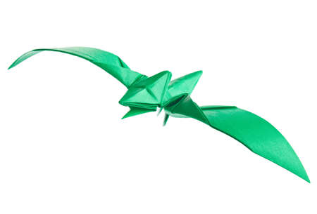 Green pterodactyl of origami, isolated on white background. Stock Photo