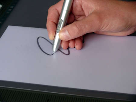 stylus pen: portrait of woman drawing on computer tablet