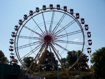 portrait of ferris wheel at amusement park