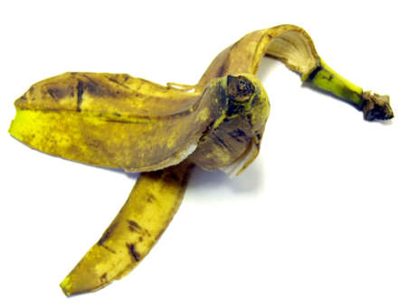 portrait of used banana at floor isolated in white photo