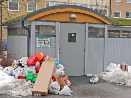 portrait of trash outside recycle house