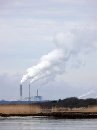 portrait of industry chimney smoke in nature sky photo