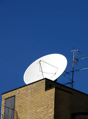 portrait of building with satellite and antenna in blue sky Stock Photo - 817830