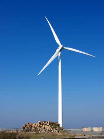 portrait of wind turbine in blue sky