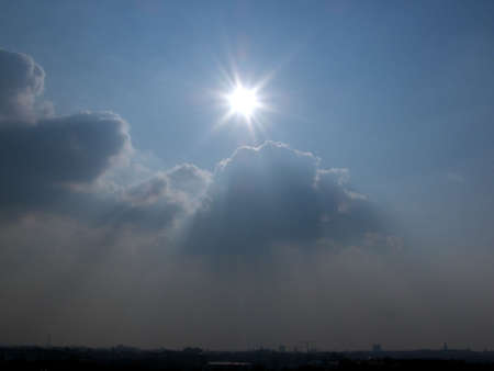 portrait of beautiful sun shining through clouds photo