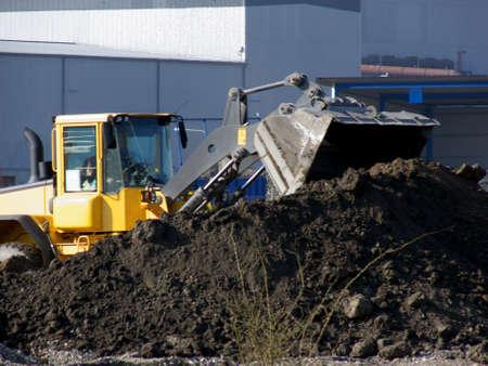 portrait of excavator at work in industrial area