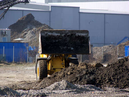 portrait of excavator at work in industrial area  Stock Photo - 852607
