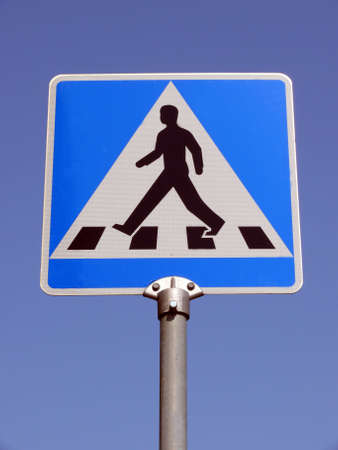 portrait of warning sign for pedestrians crossing
