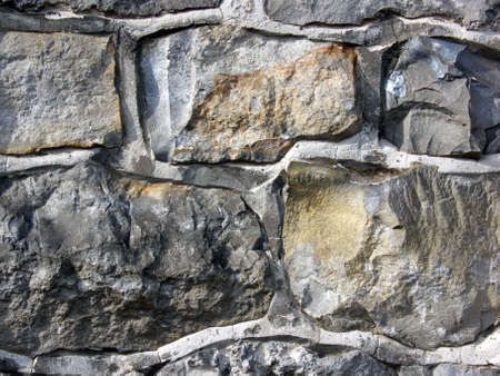 portrait of flintstone wall with big bricks photo