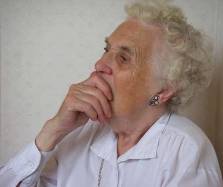 portrait of senior woman thinking