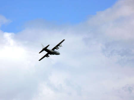 airborne vehicle: portrait of hercules c-130 military aircraft in sky on mission
