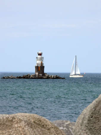 nags: portrait of lighthouse landscape background with blue sky
