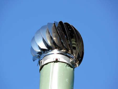 portrait of ventilation pipe in blue sky