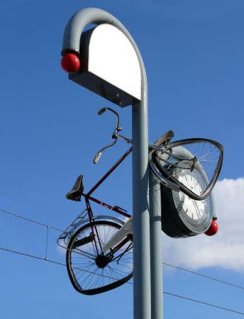 portrait of bicycle thrown in clock  Reklamní fotografie