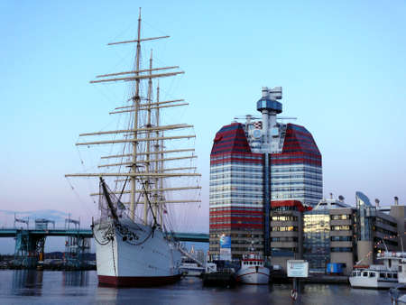 portrait of sail ship in the harbour in beautiful sunset