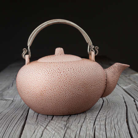 chinese teapot: Old chinese teapot on wooden background
