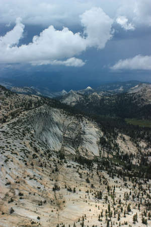 View from Cathedral Peak, the lightning rod of Yosemite National Park with a stunning view overlooking the landscape and a storm coming. Stock Photo