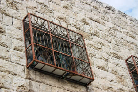 Fenced window of an Israeli Jewish settlers house in Hebron for protection of stones thrown