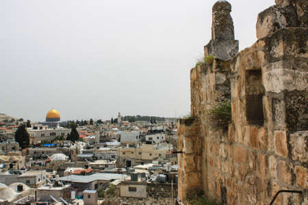 Distant and half hidden view of the city of Jerusalem with a well visible Temple mount and its holy Mosque