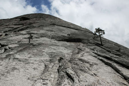 Huge granite face as seen on Half Dome's rock climbing route Snake dike in Yosemite Valley