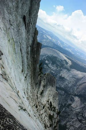 Granite abysses are one of the most majestic things one can experiencing when rock climbing in Yosemite national park Standard-Bild