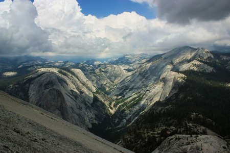 Typical view of Yosemite National Park, shot taken from the top of Half Dome which was reached rock climbing up snake dike.